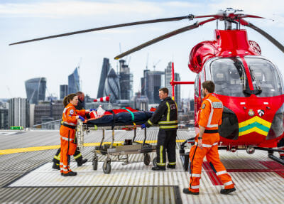 London's Air Ambulance Charity with patient at helipad