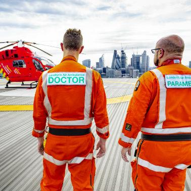 Doctor and paramedic looking at the skyline
